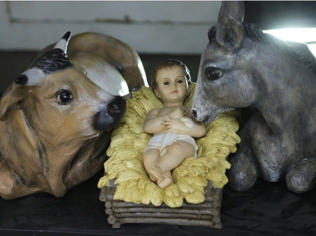 A statuette of Baby Jesus is displayed for sale in one of several religious articles shops flanking the Vatican in Rome