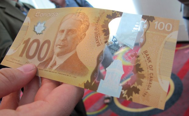 The new $100 polymer bill has a plastic feel and features a large transparent window. The new note, with expanded security features, went into circulation in November 2011. A polymer version of the $50 note made its appearance in March 2012.