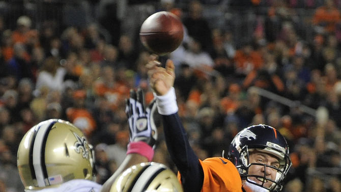 Denver Broncos quarterback Peyton Manning (18) throws a pass for a touchdown against the New Orleans Saints in the third quarter of an NFL football game, Sunday, Oct. 28, 2012, in Denver. (AP Photo/Jack Dempsey)