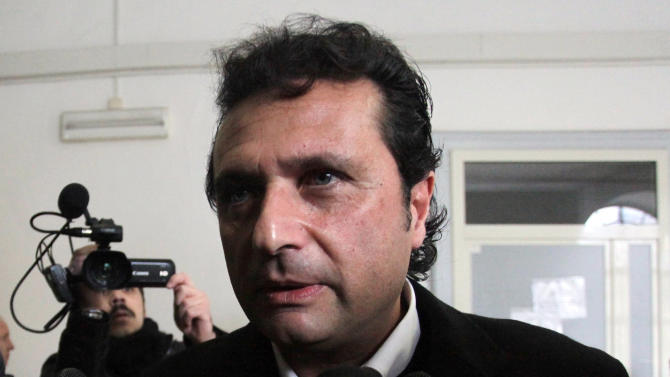 FILE -- In this photo from files taken in Naples on Jan. 30, 2013, Captian Francesco Schettino speaks to the media. The Italian captain of the Costa Concordia cruise ship was ordered on Wednesday to stand trial for manslaughter in the luxury liner's shipwreck off the coast of Tuscany, which killed 32 people. Judge Pietro Molino, at a closed door hearing in the town of Grosseto, agreed to prosecutors' requests that Francesco Schettino should be tried on charges of manslaughter, causing the shipwreck and abandoning the vessel while many of the 4,200 passengers and crew were still aboard. (AP Photo/Salvatore Laporta)