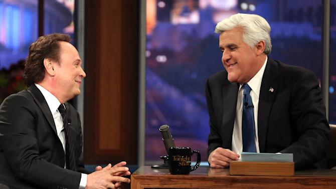 "Billy Crystal, left, talks to host Jay Leno during the final taping of  NBC's ""The Tonight Show with Jay Leno,"" in Burbank, Calif., Thursday, Feb. 6, 2014. Leno brings his 22-year career as the show host to an end Thursday in a special one-hour farewell broadcast. (Photo by Matt Sayles/Invision/AP)"