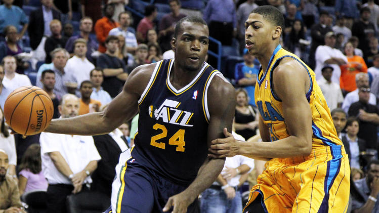 Utah Jazz power forward Paul Millsap (24) drives against New Orleans Hornets power forward Anthony Davis, right, during the first half of an NBA basketball game in New Orleans, Friday, Nov. 2, 2012. (AP Photo/Jonathan Bachman)