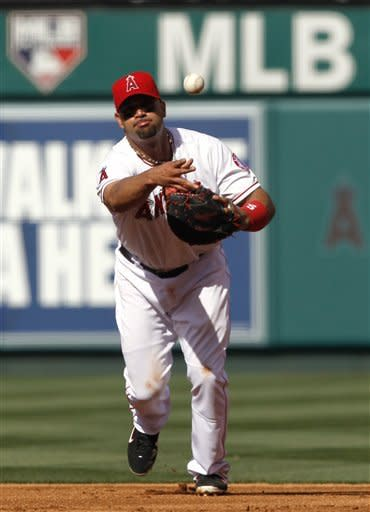 Santana, Pujols lead revived Angels past A's 4-0