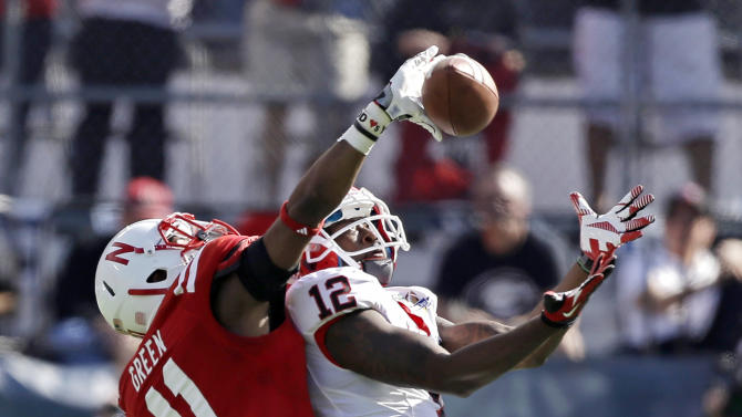Georgia wide receiver Tavarres King (12) catches a pass in front of Nebraska cornerback Andrew Green (11) for a 75-yard touchdown play during the first half of the Capital One Bowl NCAA football game, Tuesday, Jan. 1, 2013, in Orlando, Fla. (AP Photo/John Raoux)