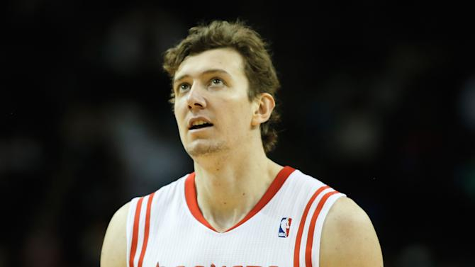 Omer Asik of the Houston Rockets walks up the court during the game against the Atlanta Hawks at Toyota Center on November 27, 2013 in Houston, Texas