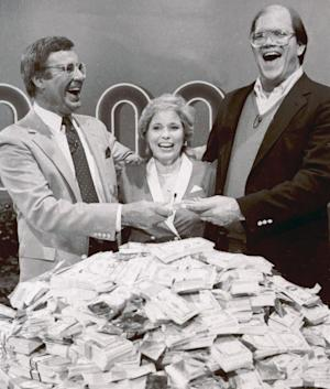 """File-This Jan. 16, 1986. file photo shows host Jim Lange, left, congratulating Connie and Steve Rutenbar of Mission Viejo, Calif., after they won $1 million on the TV show """" The $1,000,000 Chance of a Lifetime"""". Lange, the first host of the popular game show """"The Dating Game,"""" has died at his home in Mill Valley, Calif. He was 81. He died Tuesday morning after suffering a heart attack, his wife Nancy told The Associated Press Wednesday, Feb. 26, 2014. (AP Photo/File)"""