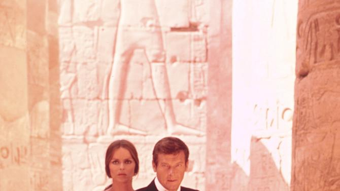 """This undated publicity photo provided by United Artists and Danjaq, LLC shows Roger Moore, right, as James Bond, and Barbara Bach as Major Anya Amasova, in the 1977 film, """"The Spy Who Loved Me."""" Moore, played Bond in seven films, more than any other actor. The film is included in the MGM and 20th Century Fox Home Entertainment Blu-Ray """"Bond 50"""" anniversary set. (AP Photo/United Artists and Danjaq, LLC)"""
