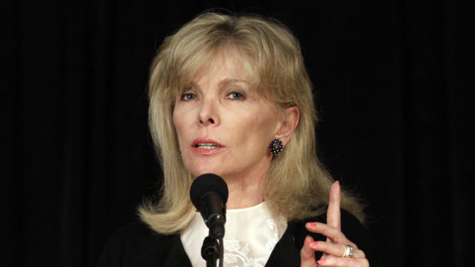 FILE - This March 24, 2011 file photo shows Darla Moore speaking to students at the University of South Carolina, in Columbia, S.C. For the first time in it's 80-year history, Augusta National Golf Club has female members. The home of the Masters, under increasing criticism the last decade because of its all-male membership, invited former Secretary of State Condoleeza Rice and South Carolina financier Moore to become the first women in green jackets when the club opens for a new season in October.  (AP Photo/Brett Flashnick)