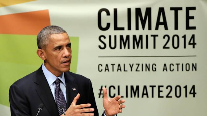 United States President Barack Obama addresses the Climate Summit, at United Nations headquarters, Tuesday, Sept. 23, 2014. (AP Photo/Richard Drew)