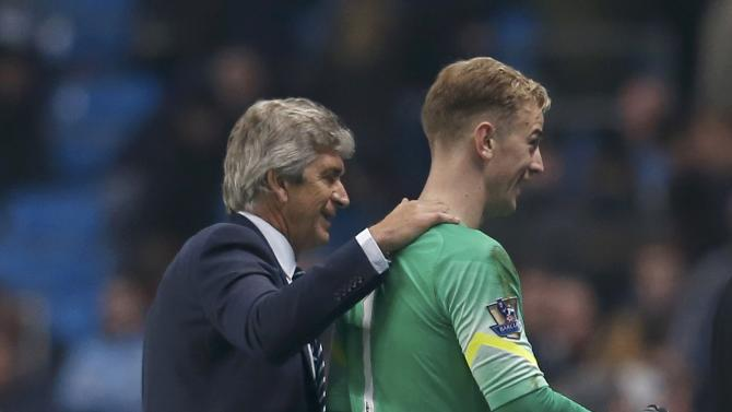 Manchester City manager Manuel Pellegrini and goalkeeper Joe hart walk off the pitch after their English Premier League soccer match against Swansea City at the Etihad stadium in Manchester