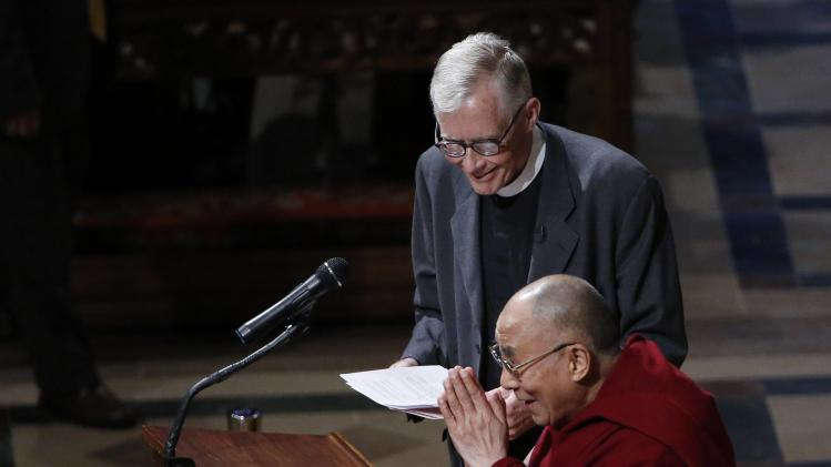 The Dalai Lama greets the audience before his speech at the National Cathedral in Washington