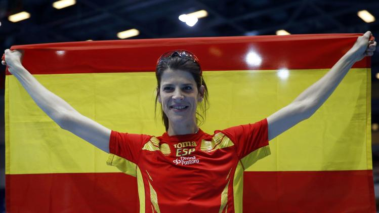 Spain's Beitia celebrates after winning bronze in the women's high jump final at world indoor athletics championships in Sopot