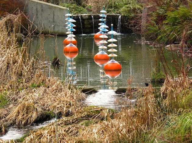 In this Feb. 11, 2013 photo, art complements science on this settlement pond in Seattle's Northgate neighborhood. Sediment ponds slow the flow of storm water, allowing particles and pollutants to settle out. The accumulations are removed every five years or so by Seattle Public Utilities crews, leaving cleaner and clearer water to flow downstream. (AP Photo/Dean Fosdick)