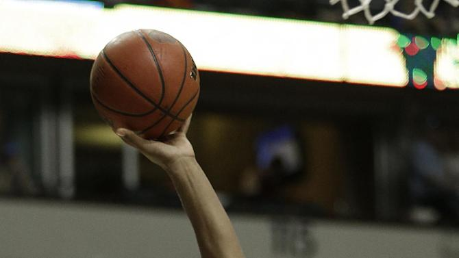 Alabama forward Nick Jacobs (15) shoots into the defense of Florida forward/center Erik Murphy (33) during the first half of an NCAA college basketball game at the Southeastern Conference tournament, Saturday, March 16, 2013, in Nashville, Tenn. (AP Photo/John Bazemore)