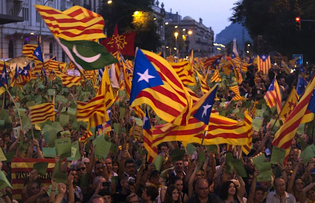FILE - Demonstrators wave Catalan flags during a protest rally in Barcelona , Spain, in this Tuesday, Sept. 11, 2012 file photo. Thousands of people demonstrated in Barcelona on Tuesday demanding independence for Catalonia, on the Catalonia region&#39;s &#39;National Day&quot;. On Thursday, regional lawmakers voted to hold a referendum for Catalonia&#39;s seven million citizens to decide whether they want to break away from Spain. The Spanish government says that the referendum would be unconstitutional. And it&#39;s unclear if the &quot;Yes&quot; vote would win  even in these restless times. But it looks more likely than ever that Catalonia may ask to go its own way. (AP Photo/Emilio Morenatti, File)