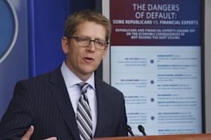 White House press secretary Jay Carney uses a visual …
