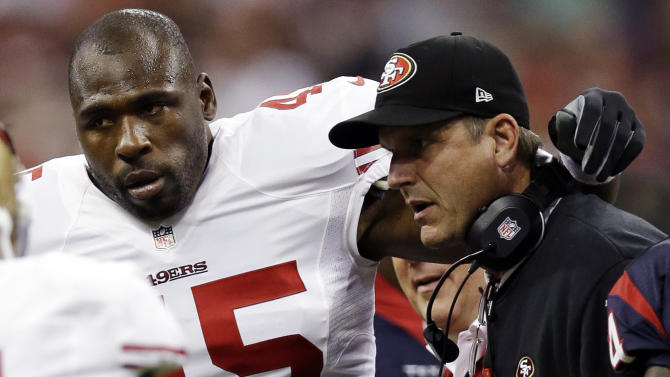 "File - In this Aug. 18, 2012, file photo, San Francisco 49ers' Brandon Jacobs (45) is helped off by head coach Jim Harbaugh in the first quarter of an NFL preseason football game against the Houston Texans in Houston. Jacobs has posted advice on Twitter with a reference to never working ""in a place where you hate your boss so much.""  The hash tag: ""YouLiveAndYouLearn."" Jacobs had terrible timing with the tweet Thursday, Nov. 15, 2012, considering coach Harbaugh was hospitalized for what the team called a ""minor procedure"" for an irregular heartbeat. In the locker room soon after his post, Jacobs said people shouldn't ""assume"" his remarks were football-related, then followed up with more tweets. He made one post saying that ""football is not my life."" (AP Photo/David J. Phillip, File)"