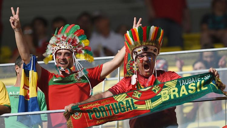Portugal fans cheer before the start of the group G World Cup soccer match between the United States and Portugal at the Arena da Amazonia in Manaus, Brazil, Sunday, June 22, 2014