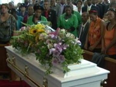 Hundreds Mourn at Funeral …