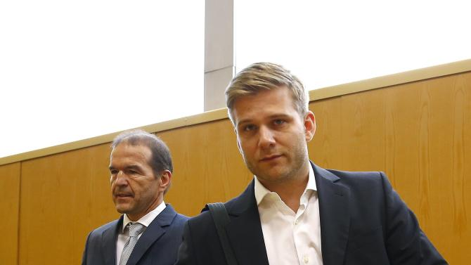 Nestmann head of Uber Germany arrives with his lawyer Meier for start of court hearing brought by Taxi Deutschland at high court in Frankfurt