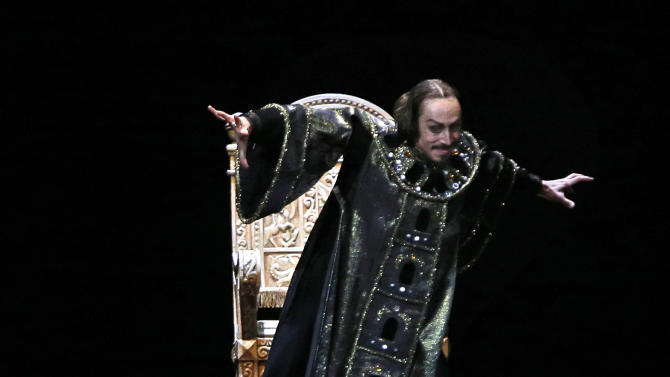 FILE  - In this file photo taken on Sunday, Nov. 4, 2012, Russian dancer Pavel Dmitrichenko as Ivan the Terrible, top, performs at a dress rehearsal of  Ivan the Terrible (Russian Tsar Ivan the Terrible) in the Bolshoi Theater in Moscow,  Russia. Three men are detained for an acid attack that severely burned the face and eyes of Bolshoi ballet director Sergei Filin. Russian police say one of them is star dancer Pavel Dmitrichenko. The two others are the suspected attacker and a man who allegedly transported him to and from the scene.(AP Photo/Alexander Zemlianichenko, File)