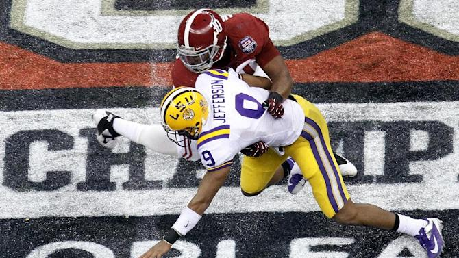 LSU's Jordan Jefferson fumbles as he is hit by Alabama's Dont'a Hightower (30) during the second half of the BCS National Championship college football game Monday, Jan. 9, 2012, in New Orleans. (AP Photo/Bill Haber)