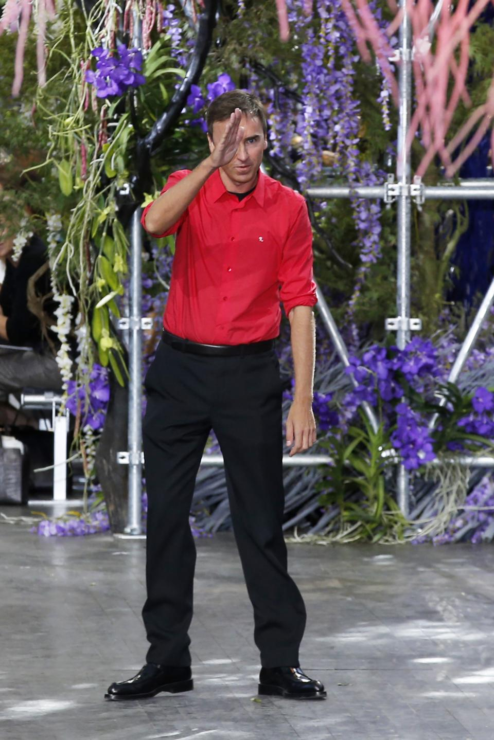 Fashion designer Raf Simons acknowledges applause following the presentation of the ready-to-wear Spring/Summer 2014 fashion collection he designed for Christian Dior, Friday, Sept. 27, 2013 in Paris. (AP Photo/Christophe Ena)