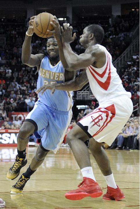 Denver Nuggets' Kenneth Faried, left, goes to the basket against Houston Rockets' Terrence Jones in the first half of an NBA basketball game Saturday, Nov. 16, 2013, in Houston