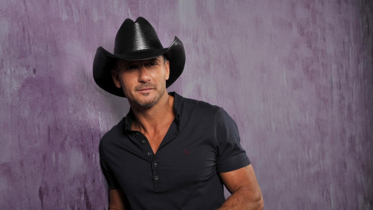 "This Jan. 15, 2013 photo shows country singer and actor Tim McGraw in Nashville, Tenn. His latest album, ""Two Lanes of Freedom,"" will be released on Tuesday, Feb. 5.  (Photo by Donn Jones/Invision/AP)"
