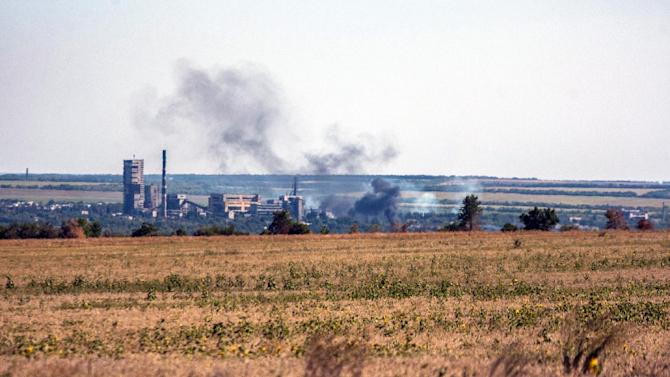 Smoke rises from explosions on the outskirts of Lugansk, eastern Ukraine during shelling on August 26, 2014