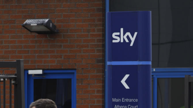A man walks to the entrance of one of the BSkyB headquarter buildings complex, in west London, Tuesday, April 3, 2012. Media executive James Murdoch, under pressure over his role in Britain's tabloid phone hacking scandal, is stepping down as chairman of British Sky Broadcasting, the Sky News channel reported Tuesday, Sky, the news channel of BSkyB, said he resignation would be confirmed later Tuesday after an unscheduled board meeting. It said Murdoch would remain a board member and would be replaced as chairman by Nicholas Ferguson, the current deputy chairman. (AP Photo/Lefteris Pitarakis)
