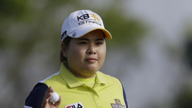 Inbee Park, of South Korea, reacts to applause after putting on the 12th hole during the first round of the U.S. Women's Open golf tournament at the Sebonack Golf Club Thursday, June 27, 2013, in Southampton, N.Y. (AP Photo/Frank Franklin II)