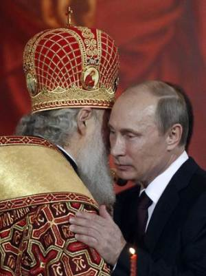 File photo of Russian President Putin kissing Kirill, …