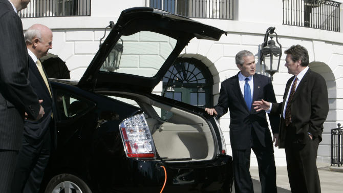 FILE - In this Feb. 23, 2007, file photo, President Bush, center, listens to Dave Vieau, President and CEO of A123 Systems, right, as he is shown a Toyota Prius plug-in hybrid car utilizing a lithium power battery during a demonstration of alternative fuel automobiles on the South Lawn of the White House.  Short of cash and hurting from slow sales of electric cars, battery maker A123 Systems Inc. sent its U.S. operations into bankruptcy protection on Tuesday, Oct. 16, 2012, and quickly sold its automotive assets. The filing is likely to stoke the debate in Washington over the Obama administration's funding of alternative energy companies. In 2009, A123 got a $249 million Department of Energy grant to help it build U.S. factories. Republicans have accused Obama of wasting stimulus money on the companies after the failure of politically connected and now-bankrupt solar power company Solyndra LLC, which left taxpayers on the hook for $528 million. (AP Photo/Charles Dharapak, File)