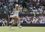 Maria Sharapova of Russia plays a return to Su-Wei Hsieh of Taiwan during a third round women's singles match at the All England Lawn Tennis Championships at Wimbledon, England, Friday, June 29, 2012. (AP Photo/Anja Niedringhaus)