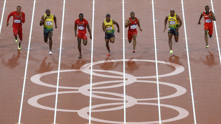 From left, United States' Ryan Bailey, Jamaica's Usain Bolt, United States' Justin Gatlin, Jamaica's Yohan Blake, United States' Tyson Gay, Jamaica's Asafa Powell and Trinidad's Richard Thompson compete in the men's 100-meter final during the athletics in the Olympic Stadium at the 2012 Summer Olympics, London, Sunday, Aug. 5, 2012. (AP Photo/Daniel Ochoa De Olza)