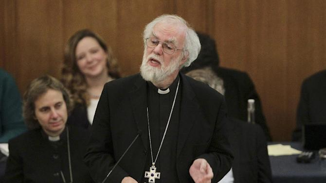 Dr Rowan Williams, centre, the outgoing Archbishop of Canterbury speaks during a meeting of the General Synod of the Church of England in central London, Tuesday, Nov. 20, 2012, - where a vote on whether to give final approval to legislation introducing the first women bishops will take place. The leader of the Church of England appealed for harmony among the faithful as it went into a vote Tuesday on whether to allow women to serve as bishops, a historic decision that comes after decades of debate. The push to muster a two-thirds majority among lay members of the General Synod is expected to be close, with many on both sides unsatisfied with a compromise proposal to accommodate individual parishes which spurn female bishops. (AP Photo/PA, Yui Mok, Pool)