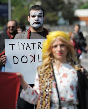 """Artists carry a banner that reads """" don't touch my theaters!"""" during a May Day rally in Istanbul, Turkey, Tuesday, May 1, 2012. Turkey, a candidate for membership in the European Union, is less strict than many other nations in the region. But Prime Minister Recep Tayyip Erdogan on Sunday backed a move by Istanbul's mayor to take over decision-making in the Istanbul City Theaters group, which is funded by the city and staged the play that outraged conservative critics.(AP Photo)"""