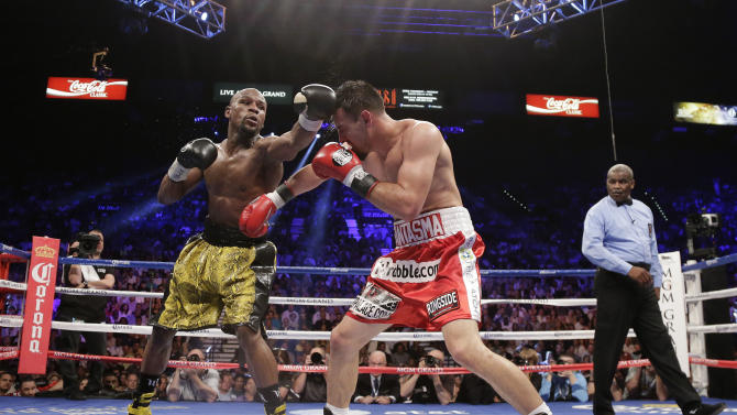 Floyd Mayweather Jr. and Robert Guerrero exchange punches in the fifth round during a WBC welterweight title fight, Saturday, May 4, 2013, in Las Vegas. (AP Photo/Rick Bowmer)