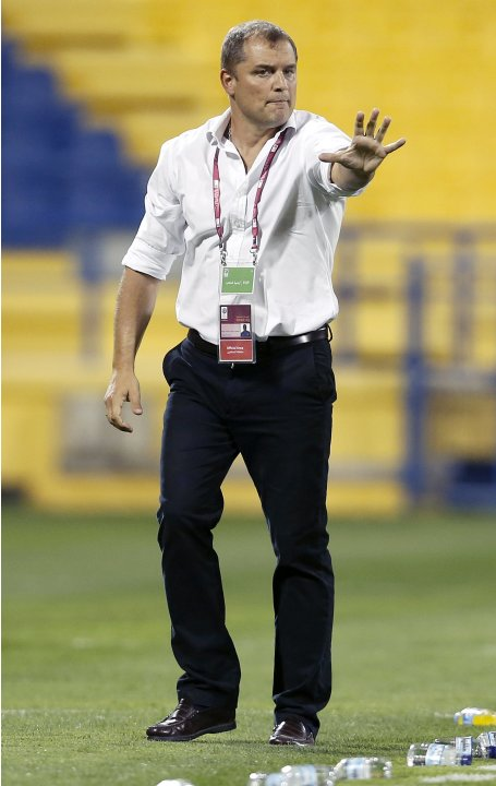 Al-Rayyan's head coach Aguirre reacts during the Qatar Stars League soccer match against Al-Gharafa in Doha