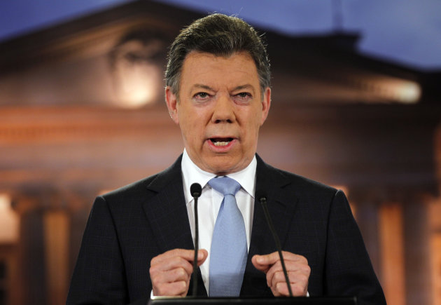 FILE - In this Aug. 27, 2012 file photo, Colombia's President Juan Manuel Santos delivers a speech during a televised address to the nation at the presidential palace in Bogota, Colombia. Santos announced Monday, Oct .1, 2012, that he has prostate cancer. He said the tumor was caught early and would be removed this week. (AP Photo/Fernando Vergara, File)