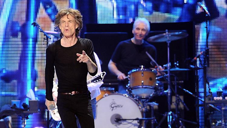 """FILE - This Dec. 15, 2012 file photo shows lead singer Mick Jagger, left, and Charlie Watts of The Rolling Stones during a performance at the Prudential Center in Newark, N.J. Before they kick off their """"50 and Counting"""" tour, the Rolling Stones are playing a warm-up date in a small club in Los Angeles.  The band is due to play the Echoplex on Saturday night before a crowd that will be miniscule compared to the thousands who are set to see them perform May 3 at the Staples Center.  (Photo by Evan Agostini/Invision/AP)"""
