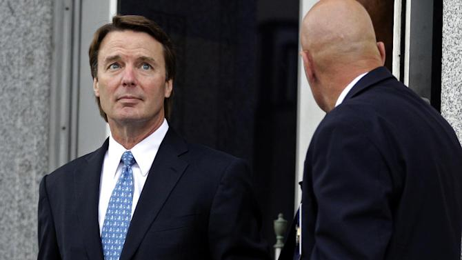 FILE - In this May 8, 2012 file photo, former presidential candidate and Sen. John Edwards, left, leaves a federal courthouse in Greensboro, N.C. Lawyers for Edwards are set to begin presenting his defense at the former presidential contender's conspiracy and campaign-finance trial on Monday, May 14, 2012. (AP Photo/Chuck Burton, File)