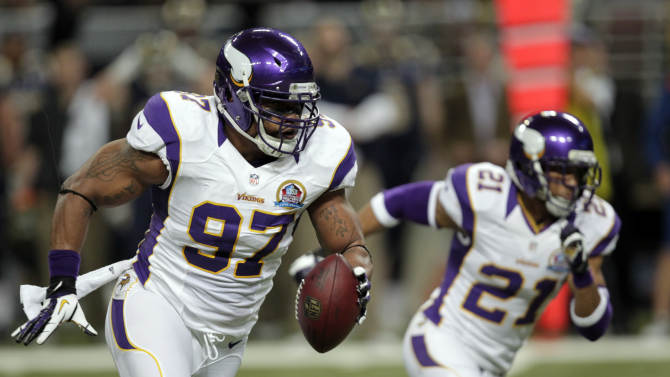 Minnesota Vikings defensive end Everson Griffen, left, runs with the ball next to teammate Josh Robinson after intercepting a pass and taking it back 29 yards for a touchdown during the second quarter of an NFL football game against the St. Louis Rams Sunday, Dec. 16, 2012, in St. Louis. (AP Photo/Tom Gannam)