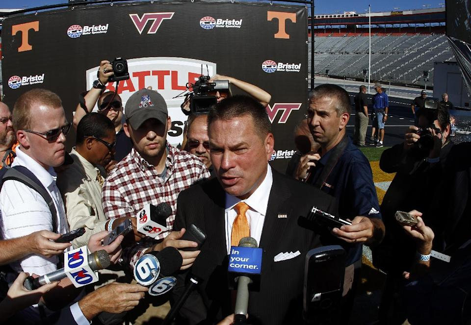 "Tennessee head football coach Butch Jones speaks with reporters after a press conference at Bristol Motor Speedway in Bristol, Tenn. Tennessee and Virginia Tech will finally play a football game at Bristol Motor Speedway in what is being billed as the ""Battle of Bristol."" (AP Photo/Wade Payne)"