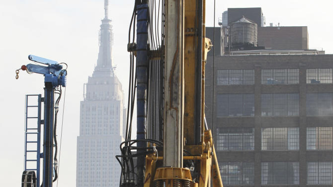 The Empire State building is seen in the background as a BG 40 drill rig breaks ground for a new neighborhood called Hudson Yards, Tuesday, Dec. 4, 2012 in New York.  The ambitious development is meant to transform the largest undeveloped property in Manhattan from an isolated rail yard into a sleek new neighborhood of spiky high-rises and graceful parks. (AP Photo/Mary Altaffer)