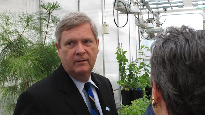U.S. Agriculture Secretary Tom Vilsack gets a tour of a plant science lab at Penn State University on Wednesday, May 16, 2012 in State College, Pa. Vilsack visited the school to promote the importance of agricultural research. (AP Photo/Genaro C. Armas)