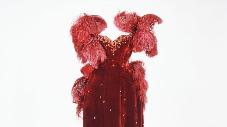 "This undated handout photo provided by the Harry Ransom Center shows the burgundy ball gown worn by Vivien Leigh as Scarlett O'Hara in ""Gone With The Wind."" The ball gown as well as the iconic green curtain dress from the 1939 film were saved from deterioration by a $30,000 conservation effort by the Harry Ransom Center at the University of Texas, and are on display for the first time in nearly 30 years at London's Victoria and Albert Museum as part of a Hollywood costume exhibit. (AP Photo/Harry Ransom Center)"