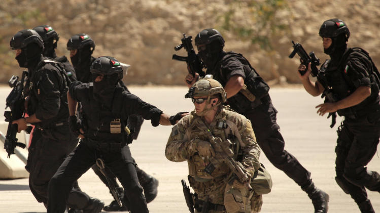 In this Thursday, June 20, 2013 photo, special operations forces from Iraq, Jordan and the U.S. conduct an exercise as part of Eager Lion multinational military maneuvers at the King Abdullah Special Operations Training Center (KASOTC) in Amman, Jordan. The first Jordanian public official to speak publicly of the numbers of U.S. troops in the kingdom, Abdullah Ensour told reporters Saturday, June 22, 2013 that 200 of the personnel were experts training for how to handle a chemical attack. He said the remaining 700 are manning a Patriot missile defence system and F-16 fighter jets which Washington deployed this month in case the Syrian war worsens.(AP Photo/Maya Alleruzzo)