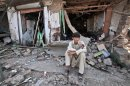 A Pakistani youth sits amid the rubble of offices destroyed in a car bomb explosion in the Pakistani town of Darra Adam Khel in the troubled Khyber Pakhtunkhwa province bordering Afghanistan, Saturday, Oct. 13, 2012. A powerful car bomb went off outside the offices of pro-government tribal elders in northwestern Pakistan on Saturday, killing several people, police said. (AP Photo/Mohammad Sajjad)